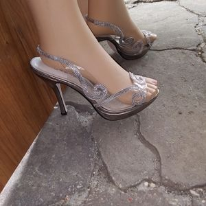 "NWOT ""Caparros"" clear & silver High heel pumps"